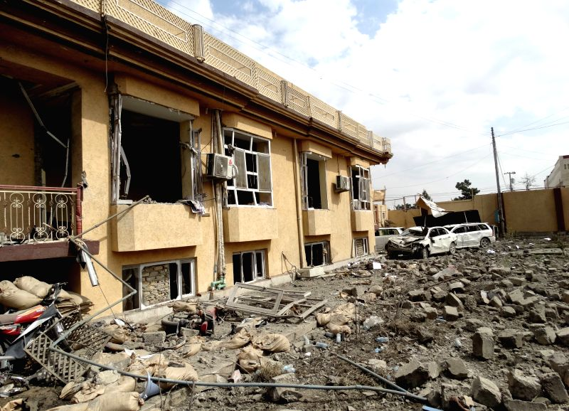 Destroyed building is seen at the site of suicide car bombing in Helmand province, southern Afghanistan, March 18, 2015. Seven civilians were killed and 46 others ...