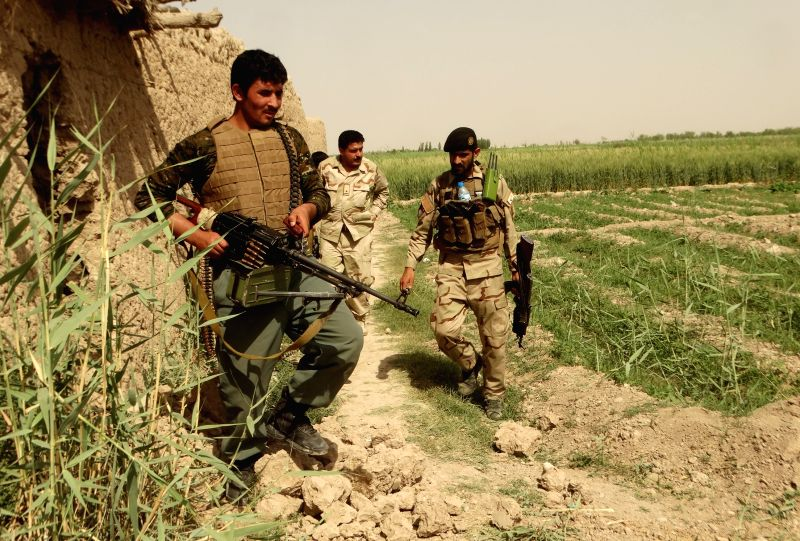 HELMAND, May 12, 2016 - Soldiers walk during a military operation in Nahr-e-Saraj district of Helmand province, Afghanistan, May 11, 2016. Some 18 Taliban militants were killed during a military ...