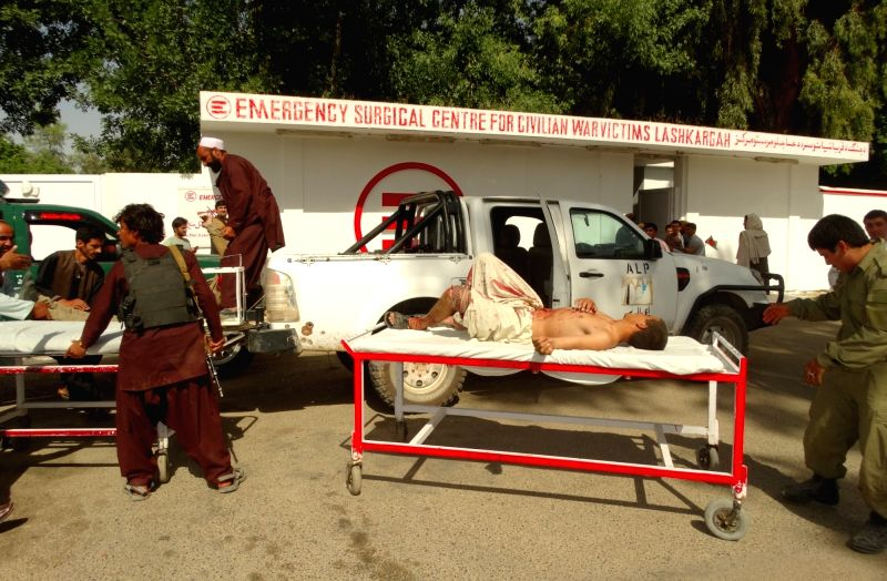 HELMAND, May 14, 2016 - People transfer injured people at a hospital after a suicide car bomb attack in Nad Ali district of Helmand province, Afghanistan, May 14, 2016. At least three people were ...