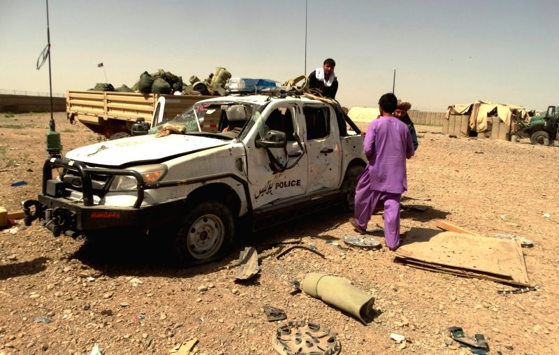 HELMAND, May 14, 2016 - Photo taken on May 14, 2016 shows a damaged military vehicle at the site of a suicide car bomb attack in Nad Ali district of Helmand province, Afghanistan. At least three ...