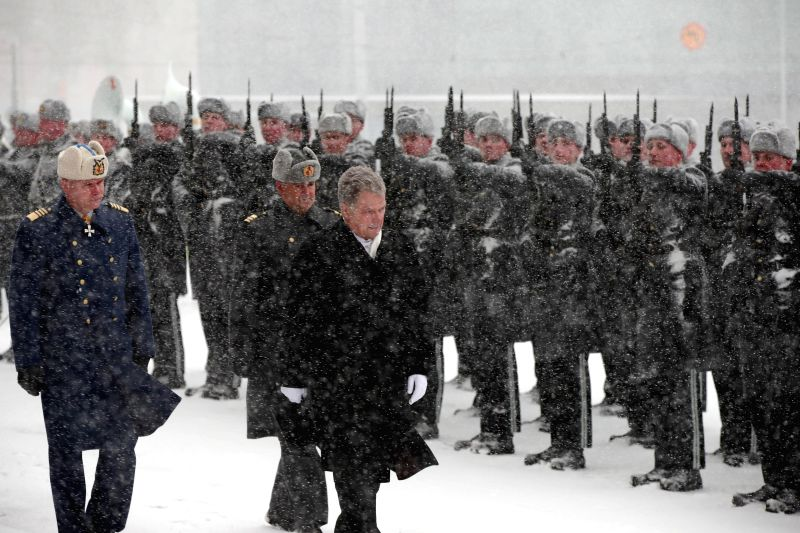 HELSINKI, Feb. 2, 2018 - Finnish President Sauli Niinisto (front) inspects the guard of honor in front of the parliament building in Helsinki, capital of Finland, on Feb. 1, 2018. Finnish President ...