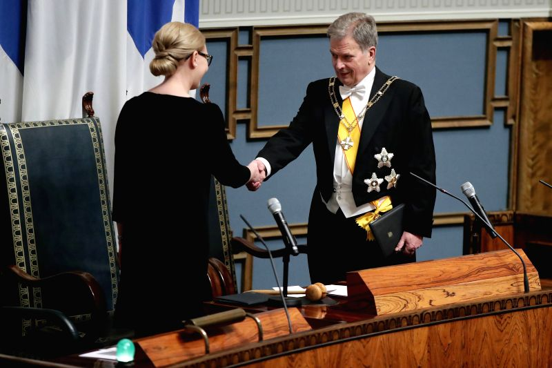 HELSINKI, Feb. 2, 2018 - Finnish President Sauli Niinisto (R) shakes hands with Speaker of Parliament Maria Lohela during the inauguration of the president in the Finnish parliament in Helsinki, ...