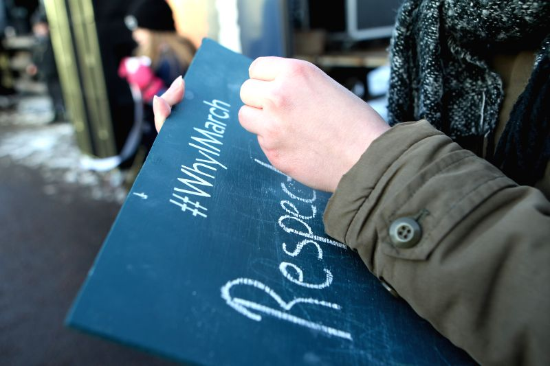 """HELSINKI, Jan. 21, 2017 - A protestor writes down """"respect"""" on a black board during a demonstration in Helsinki, Finland on Jan. 21, 2017. Some 500 people gathered in central Helsinki to ..."""