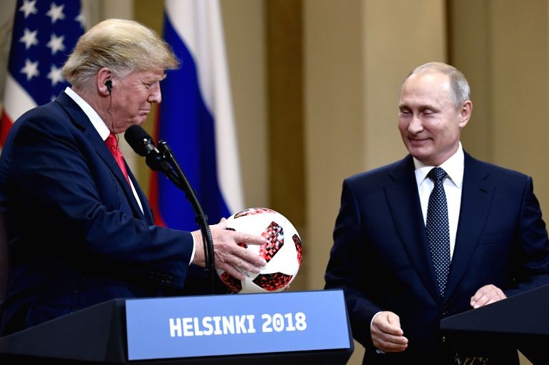 HELSINKI, July 16, 2018 - U.S. President Donald Trump (L) holds a soccer ball during a joint press conference with Russian President Vladimir Putin in Helsinki, Finland, on July 16, 2018. Donald ...