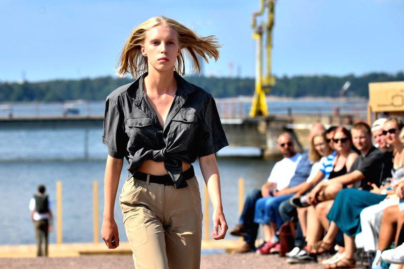 HELSINKI, July 25, 2018 - A model presents creations of German sportswear brand VAUDE during the Helsinki Fashion Week 2018 in Helsinki, Finland, July 24, 2018.