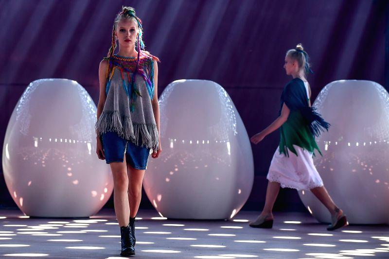 HELSINKI, July 25, 2018 - Models present creations of Finnish designer Mai Niemi during the Helsinki Fashion Week 2018 in Helsinki, Finland, July 24, 2018.