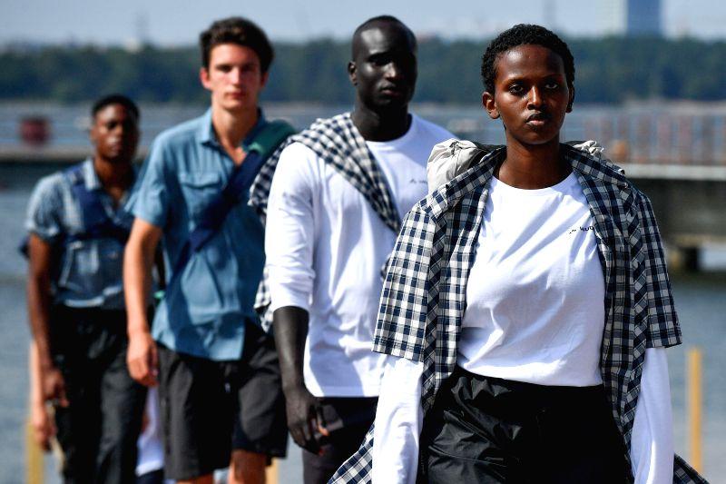 HELSINKI, July 25, 2018 - Models present creations of German sportswear brand VAUDE during the Helsinki Fashion Week 2018 in Helsinki, Finland, July 24, 2018.