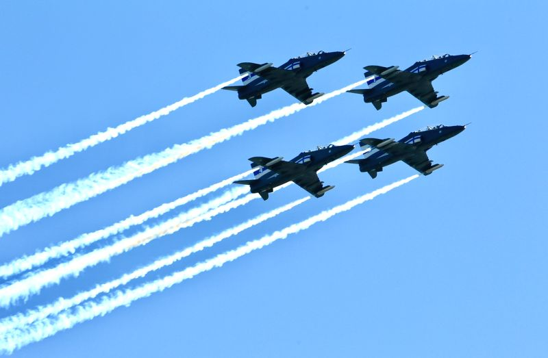 HELSINKI, June 5, 2017 - BAE Hawk jet trainers from the Finnish Midnight Hawks aerobatic team perform formation flying in Helsinki, Finland, on June 4, 2017. The flag day of the Finnish Defence ...