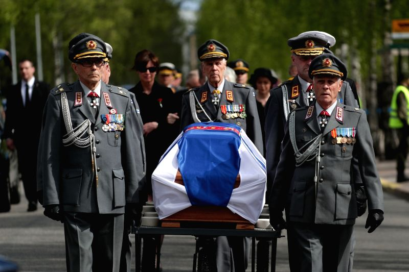 HELSINKI, May 26, 2017 - Coffin of former Finnish President Mauno Koivisto is moved during the funeral in Hietaniemi cemetery in Helsinki, Finland on May 25. 2017. Former Finnish President Mauno ...