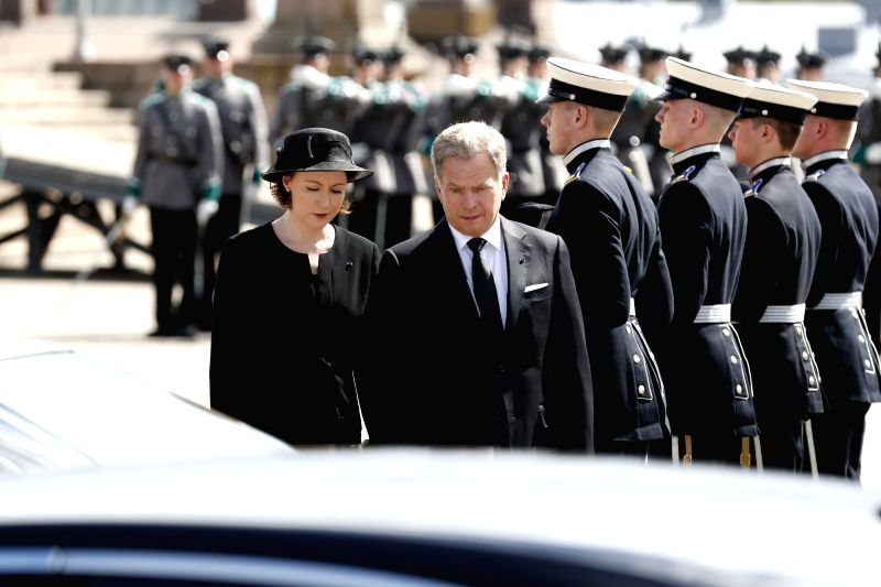 HELSINKI, May 26, 2017 - Finnish President Sauli Niinisto (2nd L, front) and his wife Jenni Haukio take part in a funeral for former Finnish President Mauno Koivisto in Hietaniemi cemetery in ...