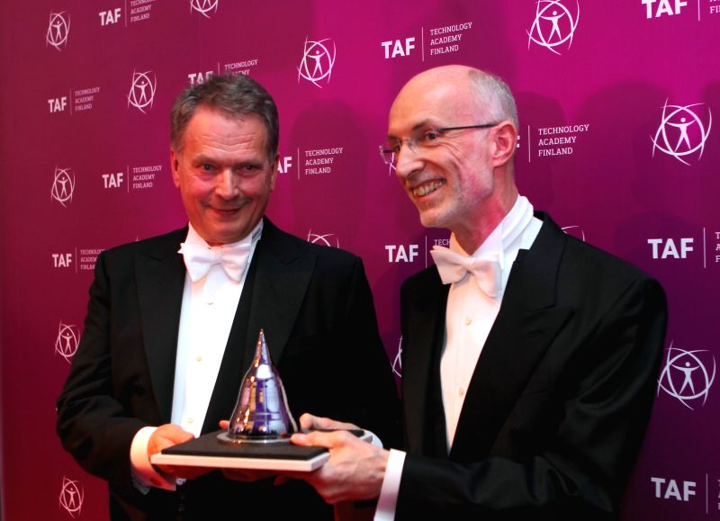 Finnish President Sauli Niinisto (L) awards Stuart Parkin, the inventor of the GMR read head, with the Millennium Technology Prize 2014 in Helsinki, Finland, on May .
