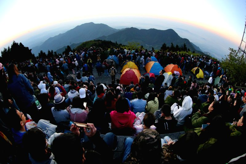 HENGSHAN, April 29, 2017 - Tourists view the sunrise at the Hengshan Mountain scenic area in Hengyang, central China's Hunan Province, April 29, 2017.