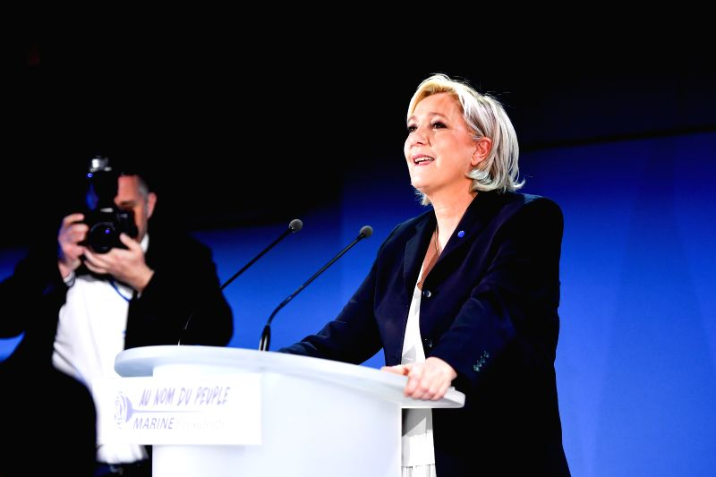 HENIN-BEAUMONT (FRANCE), April 23, 2017 Marine Le Pen (C), far-right National Front (FN) party presidential candidate, greets her supporters at a rally after the first round of French ...