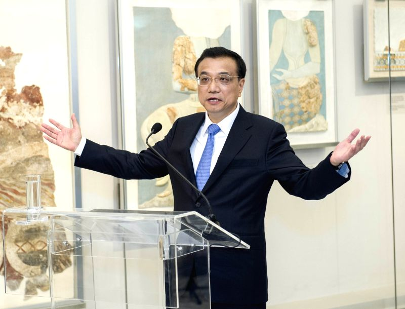 Chinese Premier Li Keqiang addresses the opening ceremony for the new hall of the Heraklion Museum in Heraklion, Crete, Greece, June 21, 2014. Greek Prime ... - Antonis Samaras