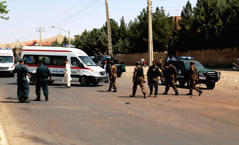 HERAT (AFGHANISTAN), July 30, 2016 Afghan security force members and medical workers arrive at the site of a blast in Herat province, Afghanistan on July 30, 2016. One person was killed ...