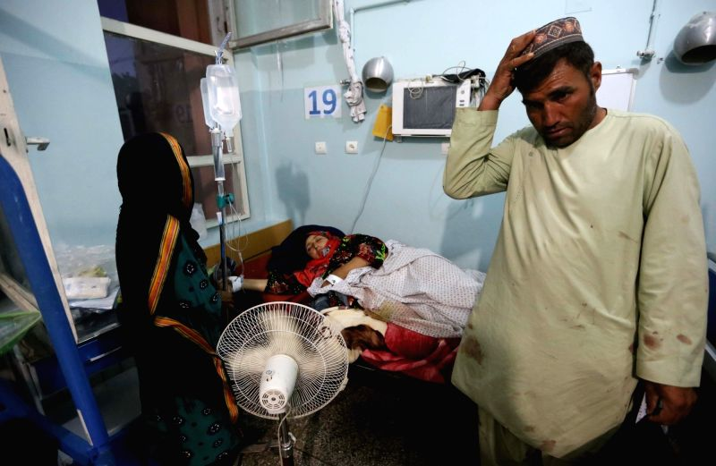 HERAT (AFGHANISTAN), May 26, 2017 An injured woman is treated at Herat regional hospital in western Afghanistan, on May 26, 2017. Ten civilians were killed and six others wounded in an ...