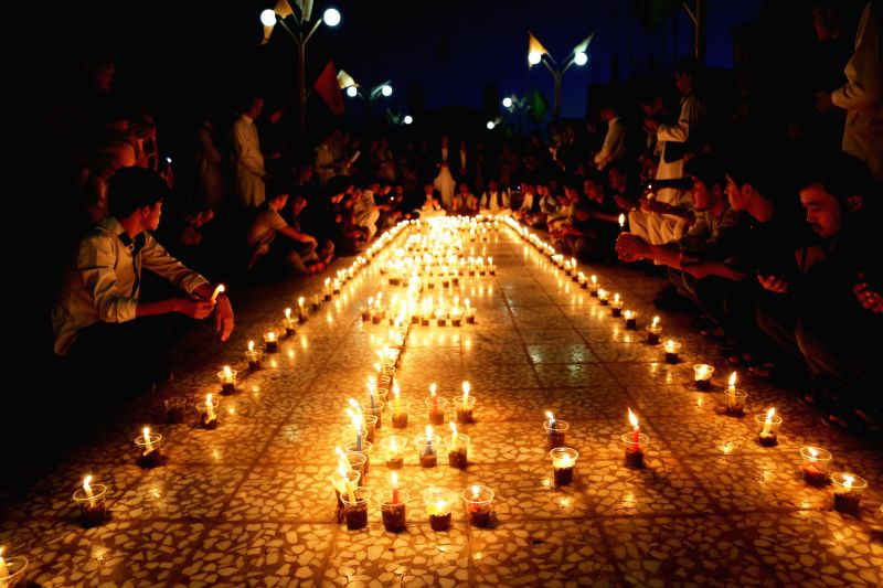 HERAT, July 25, 2016 - People attend a candlelight vigil to commemorate victims of Kabul twin bomb attack in Herat province, Afghanistan, July 24, 2016. 80 people were killed and more than 230 others ...