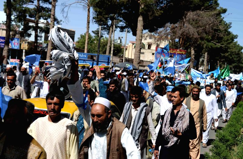 Afghan protesters shout slogans during a protest against alleged election irregularities and fraud in Herat province in western of Afghanistan on June 24, 2014. ...