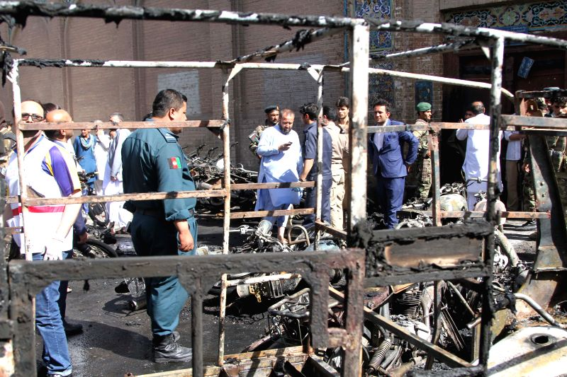 HERAT, June 6, 2017 - Photo taken on June 6, 2017 shows policemen inspecting at the blast site of Herat city, the capital of Herat, the western province of Afghanistan. Up to seven people have been ...