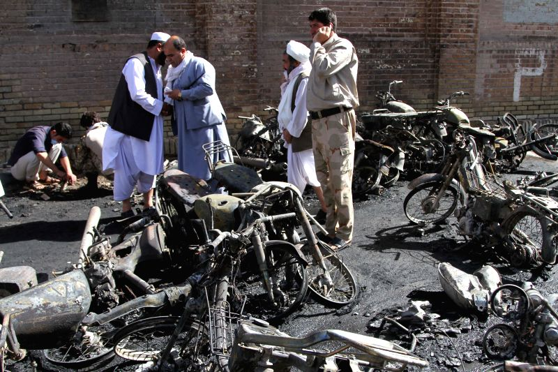HERAT, June 6, 2017 - Photo taken on June 6, 2017 shows a policeman inspecting at the blast site of Herat city, the capital of Herat, the western province of Afghanistan. Up to seven people have been ...