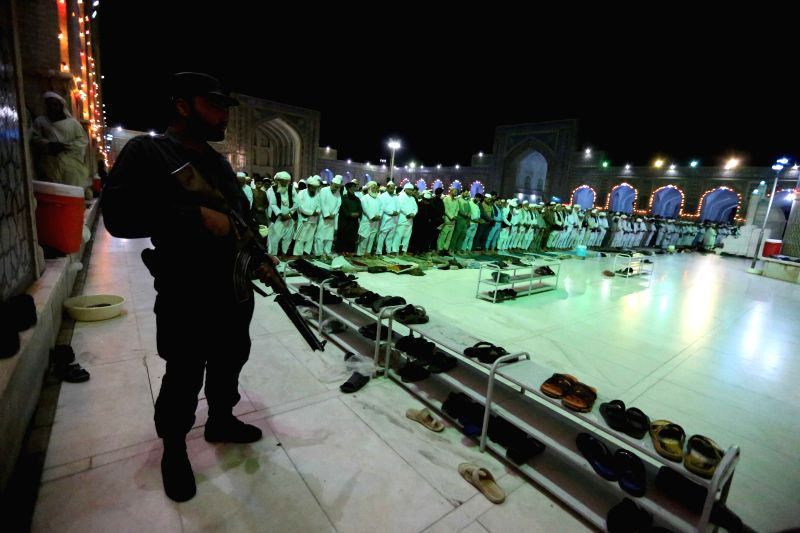 HERAT, June 8 An Afghan security force stands at a mosque during the holy month of Ramadan in Herat, western province of Afghanistan, June 7, 2017.