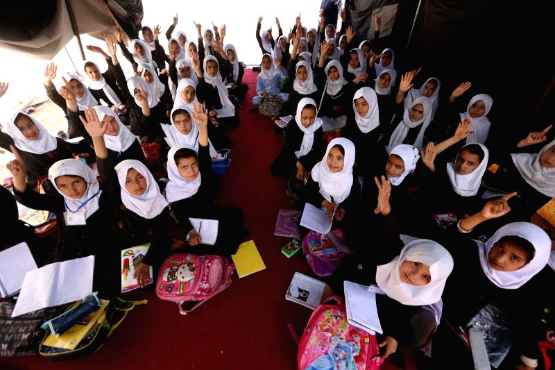 HERAT, May 25, 2017 - Afghan schoolgirls attend a class at a local school in Herat province, western Afghanistan, May 25, 2017.