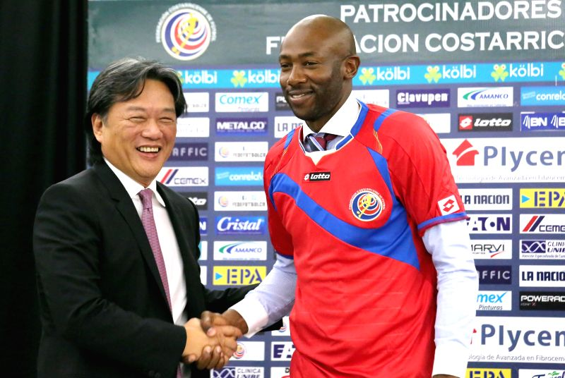 New head coach of the national soccer team of Costa Rica Paulo Cesar Wanchope (R) shakes hands with President of the Costa Rican Soccer Federation Eduardo Li during .