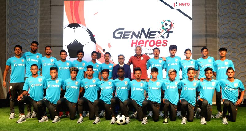 Hero MotoCorp Chairman, MD and CEO Pawan Munjal, Indian U-17 team Coach Luis Norton de Matos with the Indian U-17 team during a programme in Gurugram.