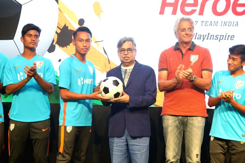 Hero MotoCorp Chairman, MD and CEO Pawan Munjal presents Indian U-17 team Captain Amarjit Singh Kiyam with a football, as a token of best wishes for the upcoming FIFA U-17 World Cup India ... - Amarjit Singh Kiyam