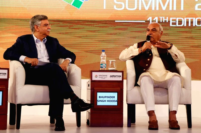 Hero MotoCorp Joint Managing Director Sunil Kant Munjal and Former Haryana Chief Minister Bhupinder Singh Hooda during Mindmine Summit 2017 in New Delhi, on April 21, 2017. - Bhupinder Singh Hooda