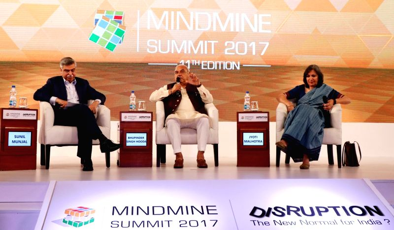 Hero MotoCorp Joint Managing Director Sunil Kant Munjal, Former Haryana Chief Minister Bhupinder Singh Hooda and Journalist Jyoti Malhotra during Mindmine Summit 2017 in New Delhi, on ... - Bhupinder Singh Hooda and Jyoti Malhotra