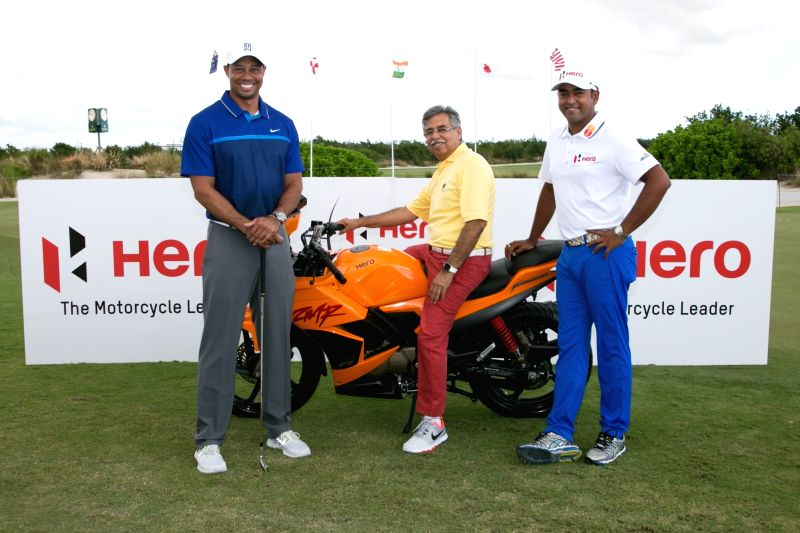Hero MotoCorp Managing Director and CEO Pawan Munjal with Tiger Woods and Ace Golfer Anirban Lahiri during Hero World Challenge 2015.