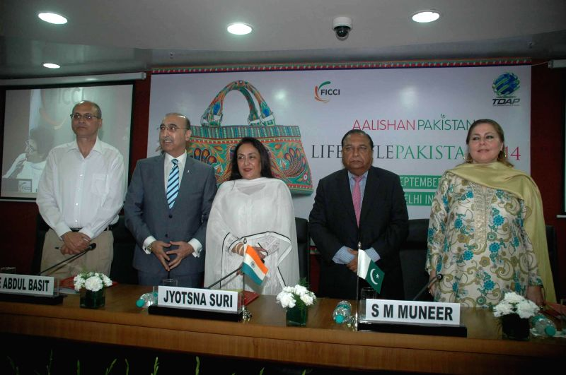 High Commissioner of Pakistan in India, Abdul Basit with Sr VP, FICCI Jyotsna Suri, during a inauguration of expo ``Aalishan Pakistan : Lifestyle Exhibition`` at FICCI in New Delhi on June 17, 2014.