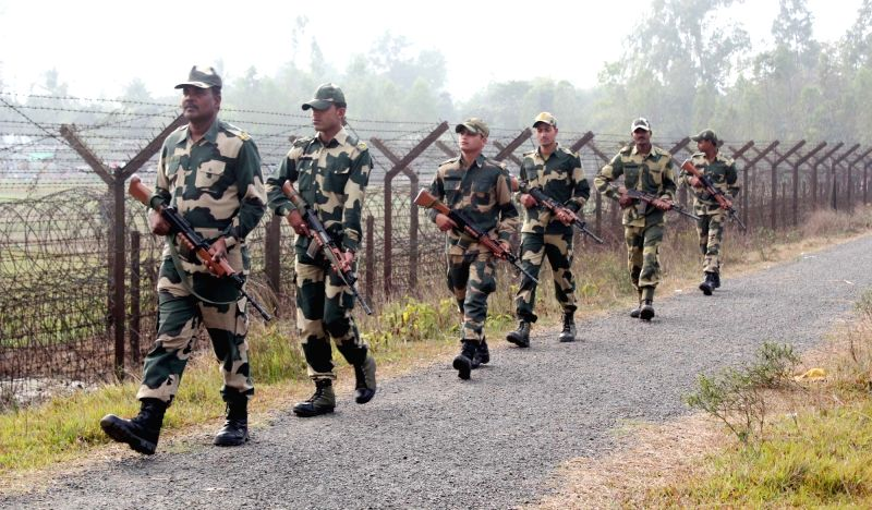 Hili: Border Security Force (BSF) soldiers on patrol duty along the India-Bangladesh Border fence at Hili near Balurghat in South Dinajpur district of West Bengal.