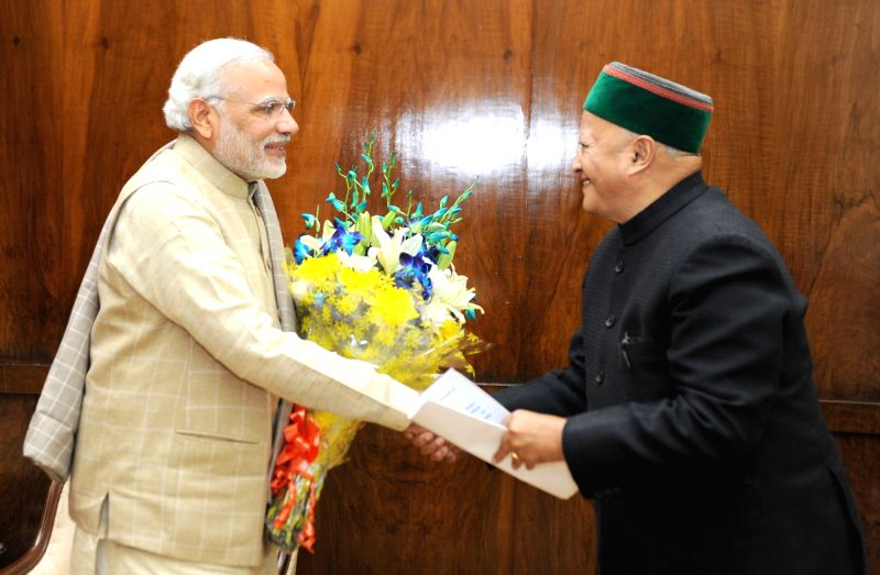 Himachal Chief Minister Virbhadra Singh calls on the Prime Minister Narendra Modi, in New Delhi on Dec 10, 2015. - Virbhadra Singh and Narendra Modi