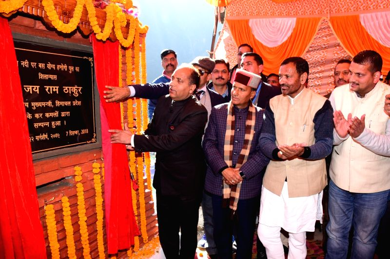 Himachal Pradesh Chief Minister Jai Ram Thakur unveils the plaque to lay the foundation stone of 100 meter span motorable double lane cable stay bridge over Beas river in Mandi on Dec 7, 2018.(Image Source: IANS)