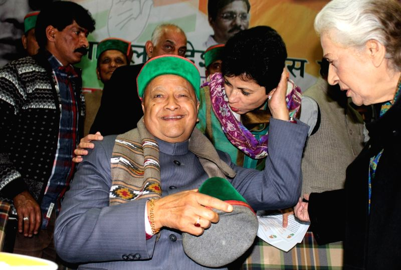 Himachal Pradesh Chief Minister Virbhadra Singh and Congress MP Kumari Selja during a programme organised to celebrate the 125th birth year  of B R Ambedkar in Shimla, on Oct 29, 2015.