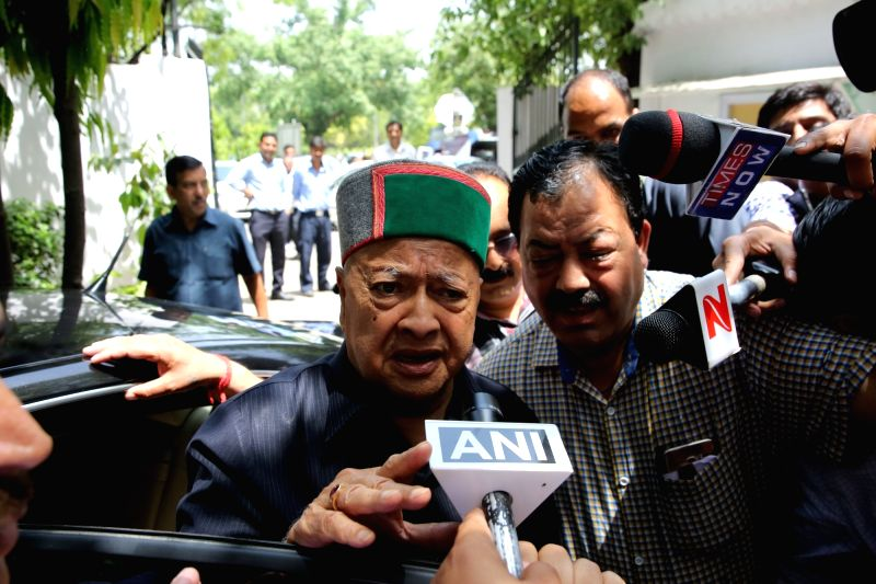 Himachal Pradesh Chief Minister Virbhadra Singh accused in a money laundering case talks to press as he arrives to appear before the Enforcement Directorate in New Delhi on April 20, 2017. ... - Virbhadra Singh
