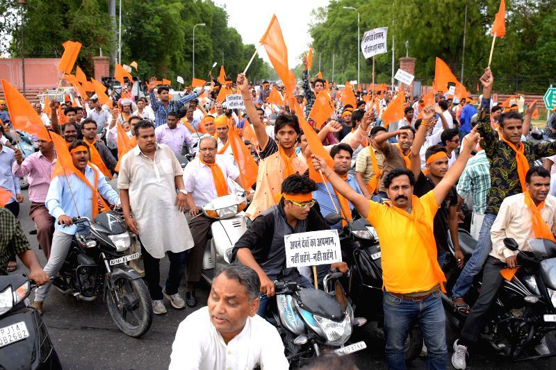 Hindu community people take out a protest rally over demolition of temples in Jaipur on July 7, 2015. About 100 big and small temples, some as old as Jaipur, were demolished to facilitate ...