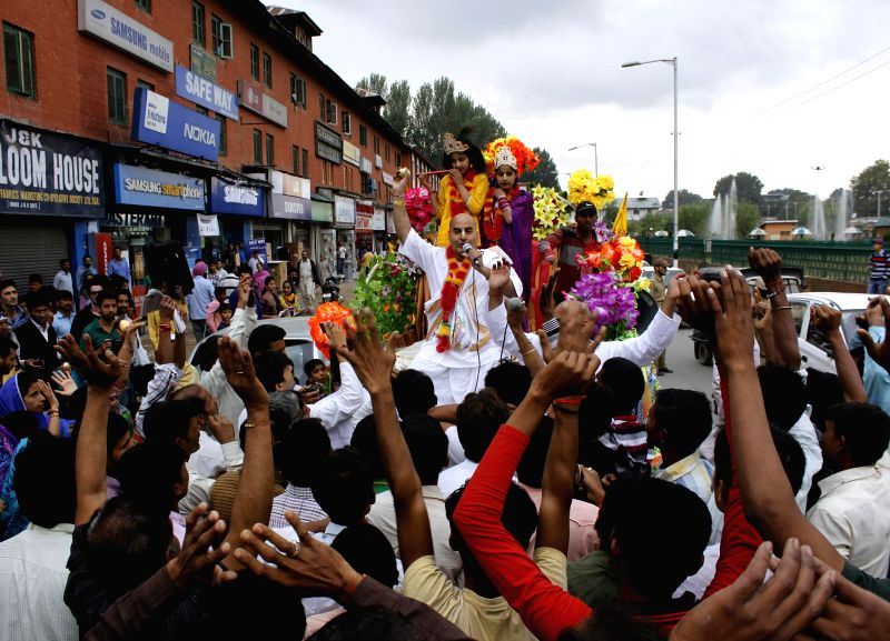 Hindu devotees celebrate on the eve of Janmastami at Lal Chowk in Srinagar on Aug. 16, 2014.