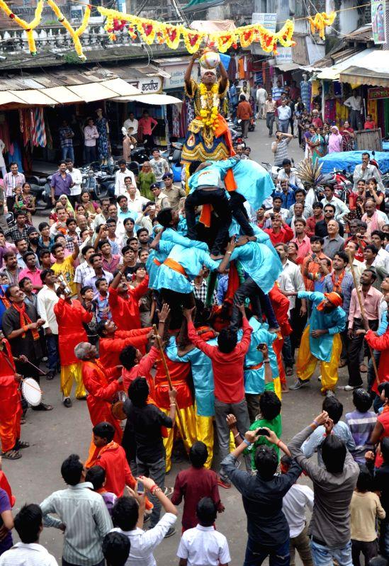 Govindas participate in the 'Dahi Handi' event during Janmashtami celebrations