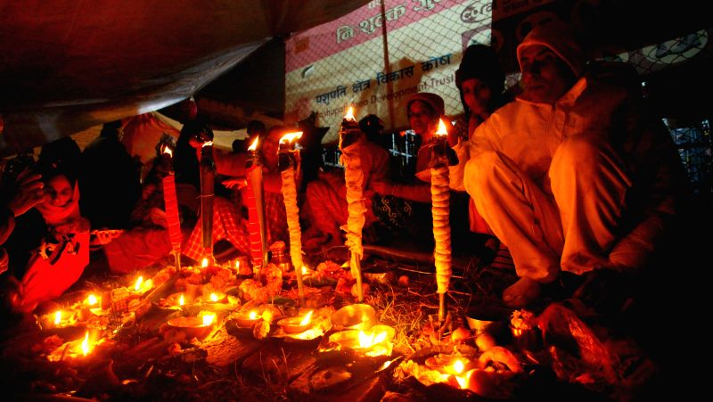Hindu devotees light oil lamps to perform religious rituals during the Bala Chaturdashi Festival at the Pashupatinath Temple in Kathmandu, Nepal, Dec. 9, 2015. ...