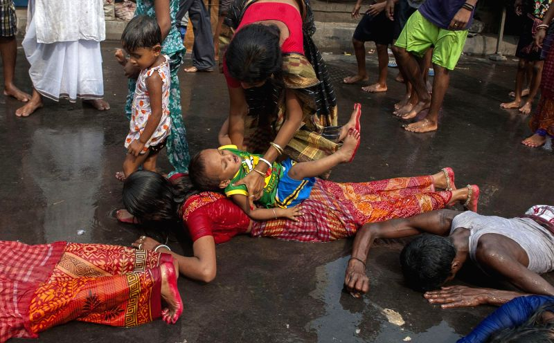 Hindu devotees performs a ritual with their childrens as a part of Sitala Puja in Kolkata on April 19, 2014.