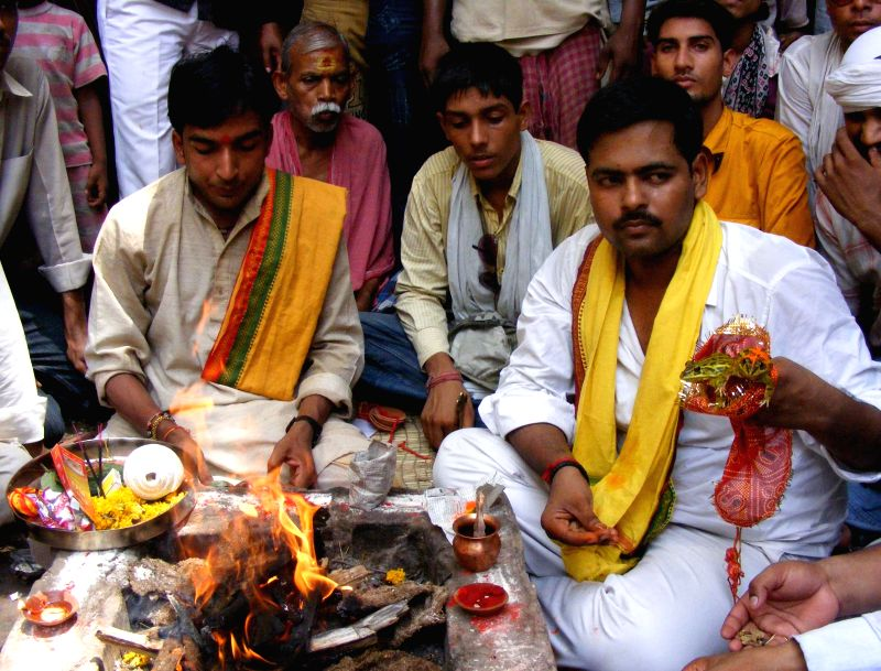 Hindu priests conduct the marriage ceremony of frogs so as to please the rain god in Varanasi.
