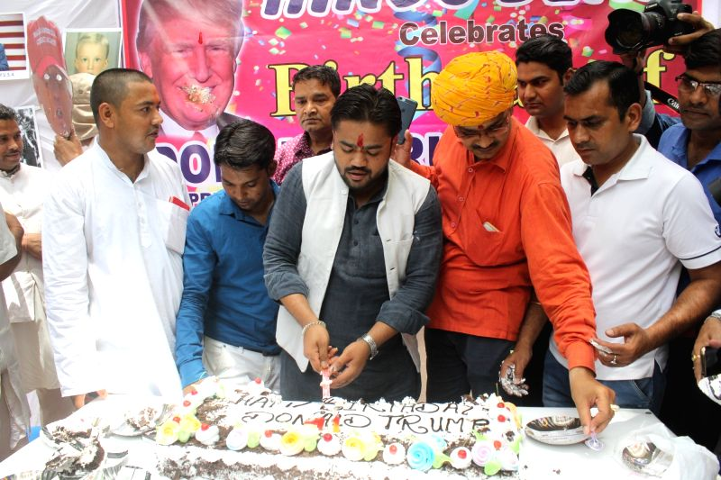 Hindu-right wing activists celebrate United States President Donald Trump's 71st birthday at Jantar Mantar in New Delhi on June 14, 2017.