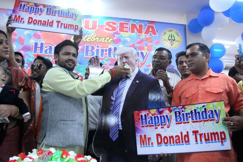 Hindu Sena activists celebrate the birthday of US President Donald Trump, in New Delhi on June 14, 2018.