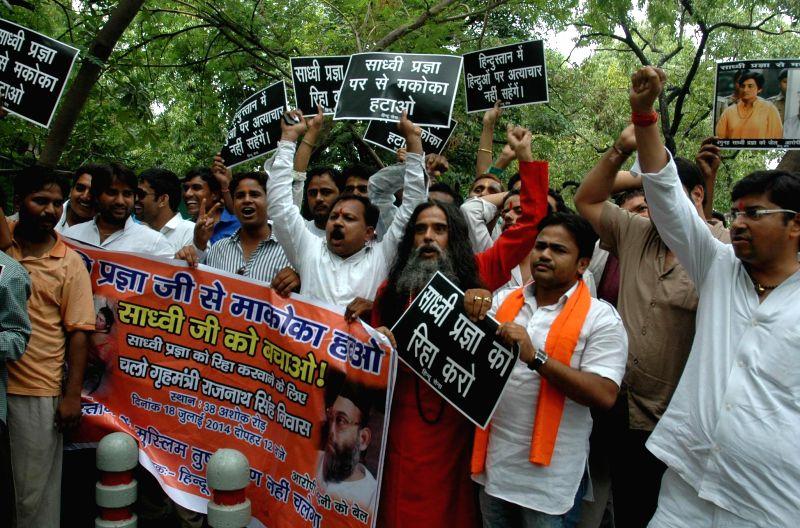 Hindu Sena activists demonstrate outside the residence of Union Home Minister Rajnath Singh in support of Sadhvi Pragya Singh Thakur - a key accused in the 2008 Malegoan blast case in New Delhi on ... - Rajnath Singh