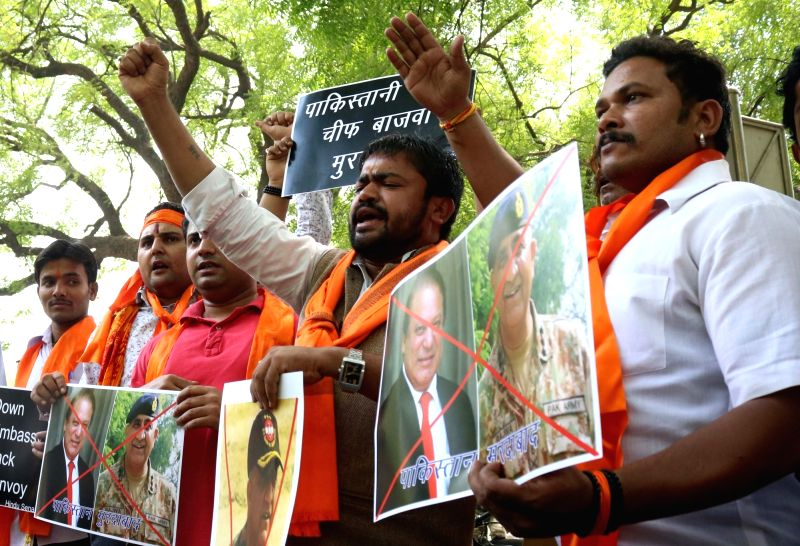 "Hindu Sena activists stage a demonstration against Pakistan's army chief General Qamar Javed Bajwa after an Army soldier and a BSF trooper were killed and ""mutilated"" on the LoC ... - Qamar Javed Bajwa"