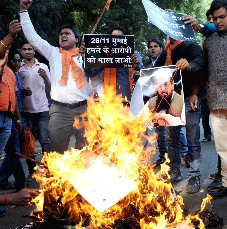 Hindu Sena workers stage a demonstration against terrorism in New Delhi, on Nov 26, 2015.