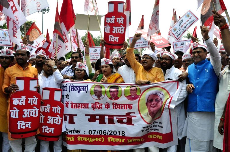 Hindustan Awami Morcha-S (HAM) workers stage a demonstration against hike in fuel prices in Patna, on June 7, 2018.